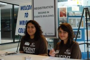 Alexandria Vizcaino with fellow Student Ambassador Kinga Szopinska assisting with Fall 2014 registration.