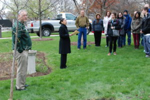 Wright College Vice President Nicole Reaves welcomes students, faculty and staff to the annual tree planting during Wright's 2015 Earth Day celebration.